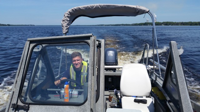James Fox smiles from a boat in the waters of Florida