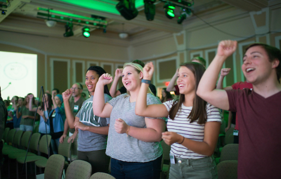 Enthusiastic students cheer at an event in Baker University Center