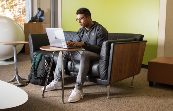 An online student studying on a laptop computer