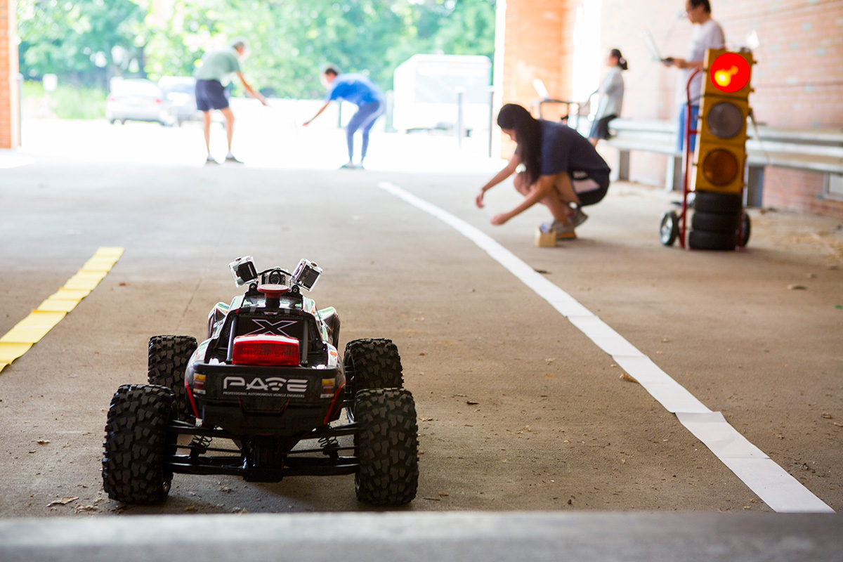 student team testing technology in a small car